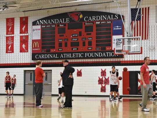 Players take the court for practice Monday at Annandale