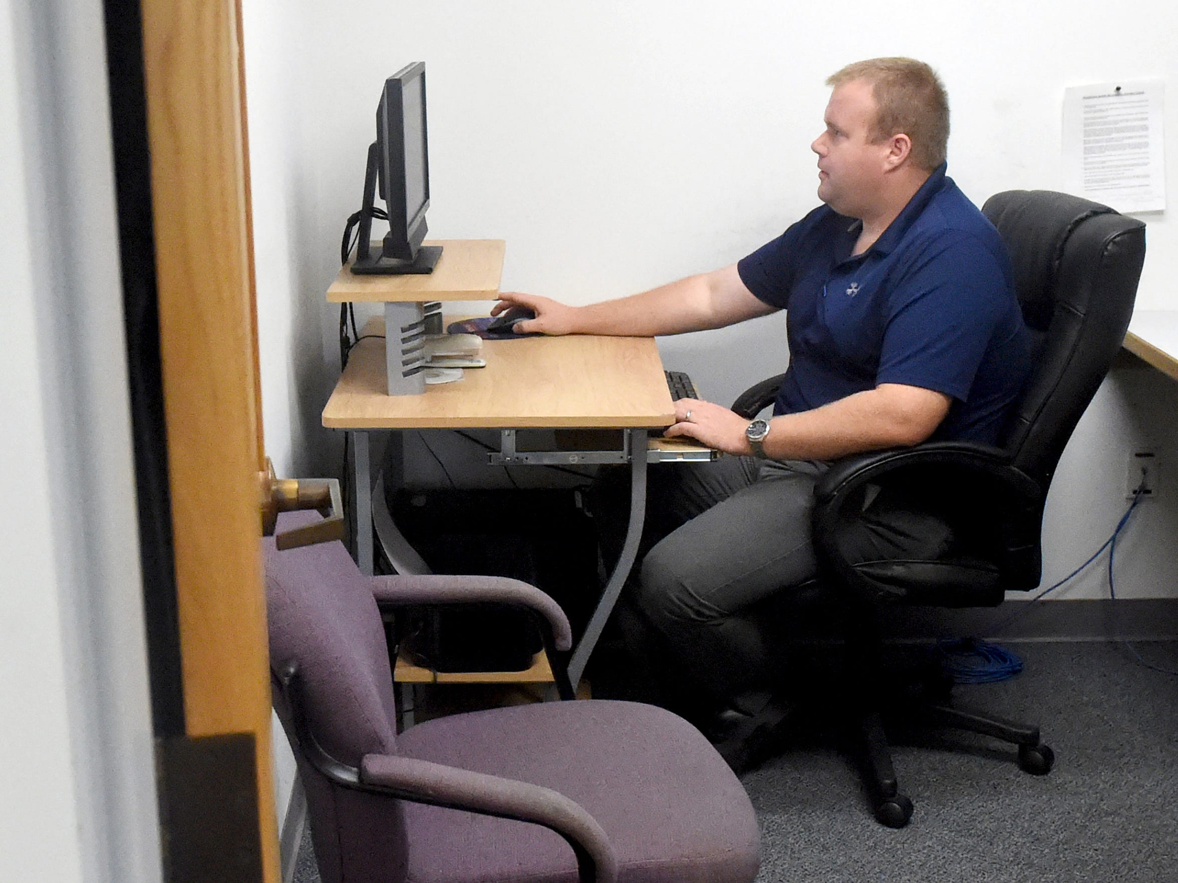 An investigator with the Staunton Police Department, Cpl. Jeremy Campbell sits at the computer he uses when trying to catch online predators.