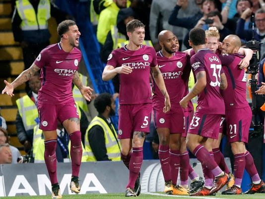 Manchester City's scorer Kevin De Bruyne, 2nd right, and his teammates celebrate the opening goal during their English Premier League soccer match between Chelsea and Manchester City at Stamford Bridge stadium in London, Saturday, Sept. 30, 2017. (AP Photo/Frank Augstein)