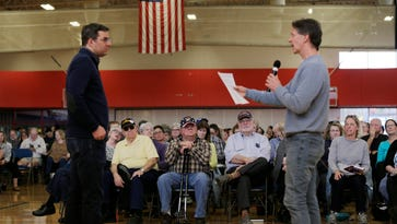 Robert Gilbert of Battle Creek, right, asks U.S. Rep. Justin Amash where he stands on the role of the EPA and how the environment should be protected from abuses during a town hall meeting at Full Blast Recreation Center in Battle Creek on Thursday, Feb. 23, 2017.