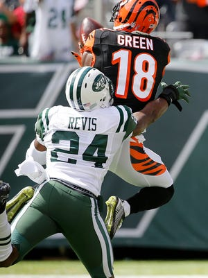 Cincinnati Bengals wide receiver A.J. Green (18) makes a catch for a touchdown over New York Jets cornerback Darrelle Revis (24) in the 2nd quarter at MetLife Stadium in East Rutherford, New Jersey, Sunday, September 11, 2016.