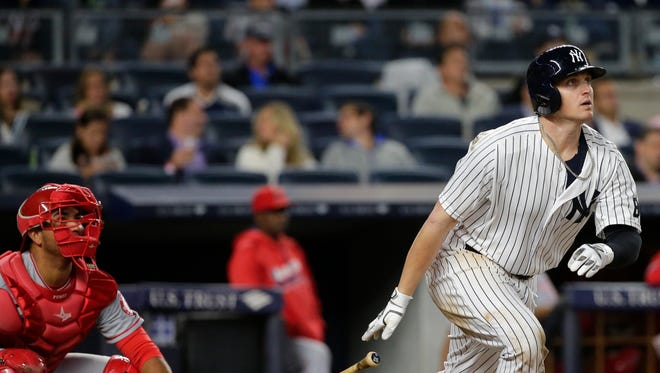 New York Yankees' Chris Parmelee watches his home run during the sixth inning of a baseball game against the Los Angeles Angels on Wednesday, June 8, 2016, in New York.