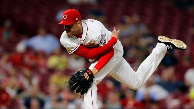 Cincinnati Reds relief pitcher Jared Hughes (48) delivers a pitch in the top of the eighth inning of the MLB National League game between the Cincinnati Reds and the Milwaukee Brewers at Great American Ball Park in downtown Cincinnati on Wednesday, May 2, 2018. The Reds fell to 7-24 with a 3-1 loss to the Brewers.