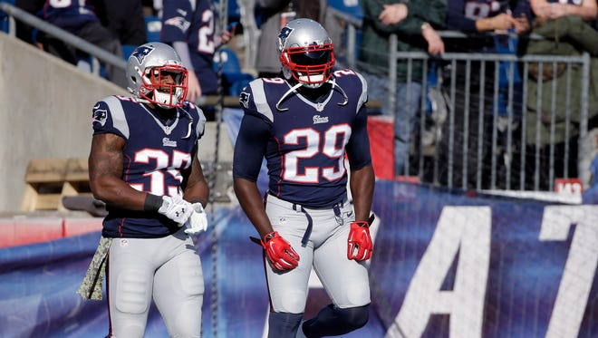 New England Patriots running backs Jonas Gray (35) and LeGarrette Blount (29) warm up before Sunday's game against the Detroit Lions in Foxborough, Mass.