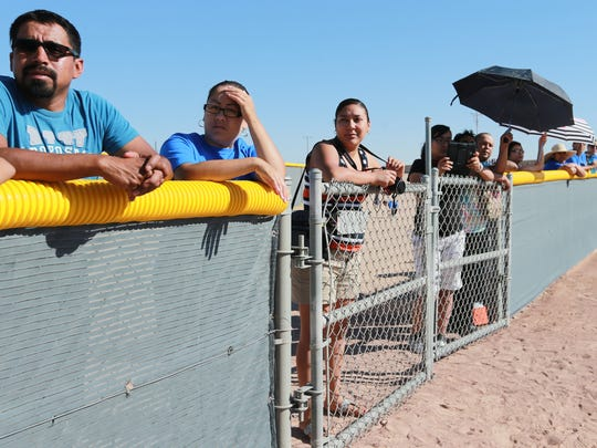 Family members watch a BASE Play game recently.