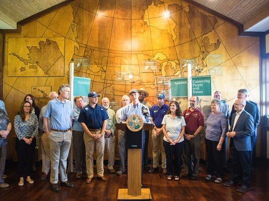 Gov. Rick Scott announced his budget recommendation of a $1.7 billion investment in Florida's environment at the Audubon Corkscrew Swamp Sanctuary Center in Naples on Monday, Oct. 23, 2017.