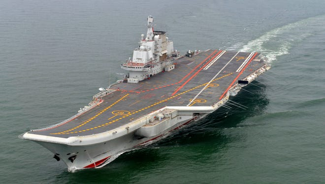 In this May 2012 file photo provided by China's Xinhua News Agency, Chinese aircraft carrier Liaoning cruises for a test on the sea.