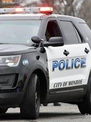 A Monroe woman has been taken into custody after authorities