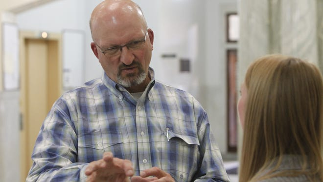 Jeff Petree, manager of the new Wiechman Pig Co. facility near Delphi, talks to Andrea Brown, a Purdue Extension educator for Carroll County, Tuesday, Oct. 27, 2015 inside the Carroll County Courthouse about the new facility and opportunities for pork producers in Carroll County.
