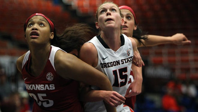 Oregon St. guard Jamie Weisner, center, battle for a rebound against Arkansas' Tatiyana Smith, left, and Bailey Zimmerman during a NCAA college women's basketball game in Guaynabo, Puerto Rico, Saturday, Nov. 28, 2015.