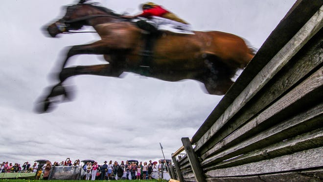 Rudyard K jumps over timbers in the mist Isabella Du Pont Sharp Memorial race during the 40th annual point-to-point race Sunday, May 06, 2018, at Winterthur Museum, Garden & Library in Wilmington Delaware.