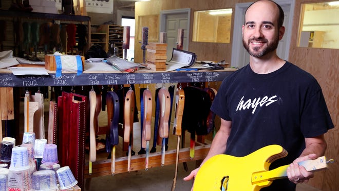 Steven A. Fazio, owner of Southbound Custom, displays a guitar that his company is working on Wednesday, May 3, 2017.