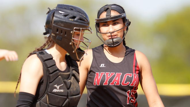 Nyack catcher Megan Sneeden (5) left, and pitcher Michaela Contreras (15) photographed during to a softball game against Tappan Zee at Nyack High School on Thursday, May 12, 2016.