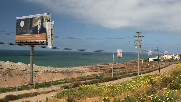 APRIL 7, 2009. TIJUANA, MEXICO. About 10 miles south of the border a billboard advertises the site of Trump Oceans Resort Baja Mexico. Nearly 100 people gave down payments to Irongate Capital Partners LLC, an L.A. developer, for condos in the oceanfront 525–unit hotel–condo towers. Donald Trump sold his name to the project for a licensing fee. Now, 2 years later Irongate has run out of money and dozens of buyers have filed lawsuits against Trump and Irongate.  (Photo by Don Bartletti/Los Angeles Times via Getty Images)