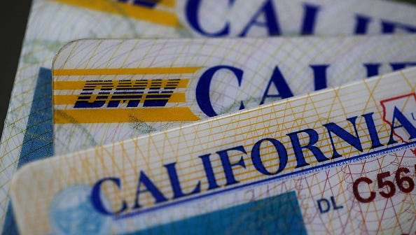 SAN ANSELMO, CA - MAY 09:  In this photo illustration, the California Department of Motor Vehicles (DMV) logo appears on a California driver license on May 9, 2017 in San Anselmo, California. California is one of 12 states that allow unauthorized immigrants to obtain driver's licenses.