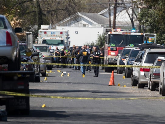 Authorities investigate an explosion March 12 in Austin, Texas.