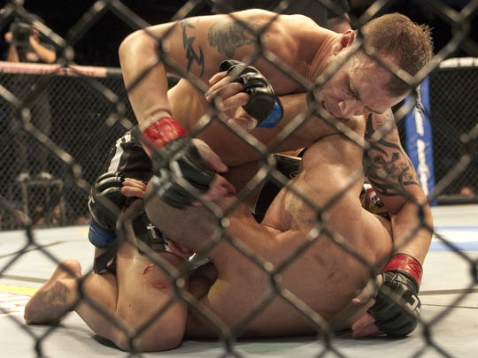 Nick Catone works on Costas Philippou during their UFC 128 bout at the Prudential Center in Newark.