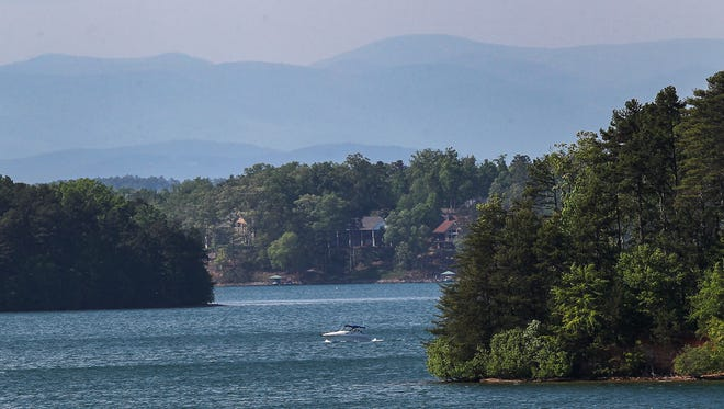 A body was found on the Lake Keowee shoreline Friday at Stamp Creek Landing.