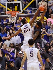 LSU's Jordan Mickey blocks a shot during the Tigers' win over South Carolina Wednesday night. Mickey blocked six shots in the game and moved into second place on LSU's career blocked shots list.