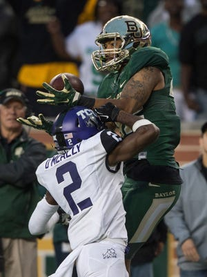 Baylor WR Levi Norwood gets the advantage on TCU's Corry O'Meally (2) in their game on Oct. 11. Will Baylor regain that advantage when the Playoff field is determined?