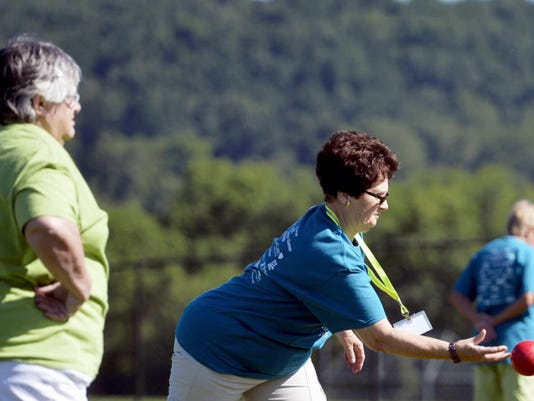 Central York High School was home of the 14th annual York County Senior Games on June 24. Here, Judith Leas, left, of York City, watches as Judy Landis, of Dover Township, releases her bocce ball. More than 500 seniors registered for 44 events, varying from table tennis to bowling to volleyball.