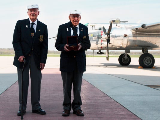 "Doolittle Raiders retired Lt. Col. Dick Cole and former Staff Sgt. David Thatcher pose with the Congressional Gold Medal after it arrived at Wright-Patterson Air Force Base, Ohio, following a ceremonial flight on board the B-25 ""Panchito"" April 18, 2015. The medal is on display in the museum's World War II Gallery in the Doolittle Raid exhibit."