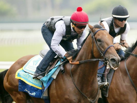 Triple Crown winner American Pharoah and jockey Martin Garcia appear during a workout, Sunday Aug. 23, 2015 at Del Mar Thoroughbred Club in Del Mar, Calif. American Pharoah will run next in the Travers Stakes at a sold-out Saratoga Race Course on Saturday.