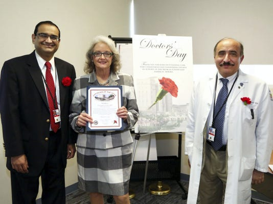 The West Palm Beach VA Medical Center announced that Dr. Georgia Gill, formerly of Lebanon, was selected as the medical center's Physician of the Year for her outstanding contribution to the Orthopedic Surgery Program at the medical center. Pictured are, from left, Dr. Deepak Mandi,  chief of staff; Gill; and Dr. Ernest Shwayri, chief of surgery.