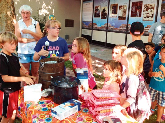 Everyone likes ice cream, and the line for the homemade ice cream at Friday´s Silver City Museum Kids Day event was the longest line at the event, which featured old-time entertainment, like wooden hoops to roll and wheelbarrows, along with a karaoke corner. Randal Seyler - Sun-News