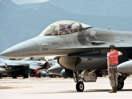 An F-16 Fighting Falcon pilot assigned to the 311th Fighter Squadron, Holloman Air Force Base, salutes a crew chief before taking off as part on an exercise during Red Flag 15-4 at Nellis Air Force Base, Nevada, Aug. 27. Red Flag involves a series of intense air-to-air combat exercises designed to prepare U.S. and allied forces for future real world conflicts.
