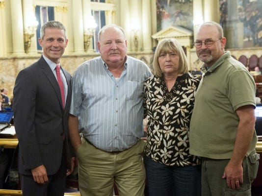 Rep. Rob Kauffman (R-Franklin) , left, sstands with James Cutchall's siblings, Jeff Cutchall, Carolyn Tash and Thomas Cutchall. James is a Fayetteville fire chief who was shot and killed when responding to a fire on July 27, 1977.