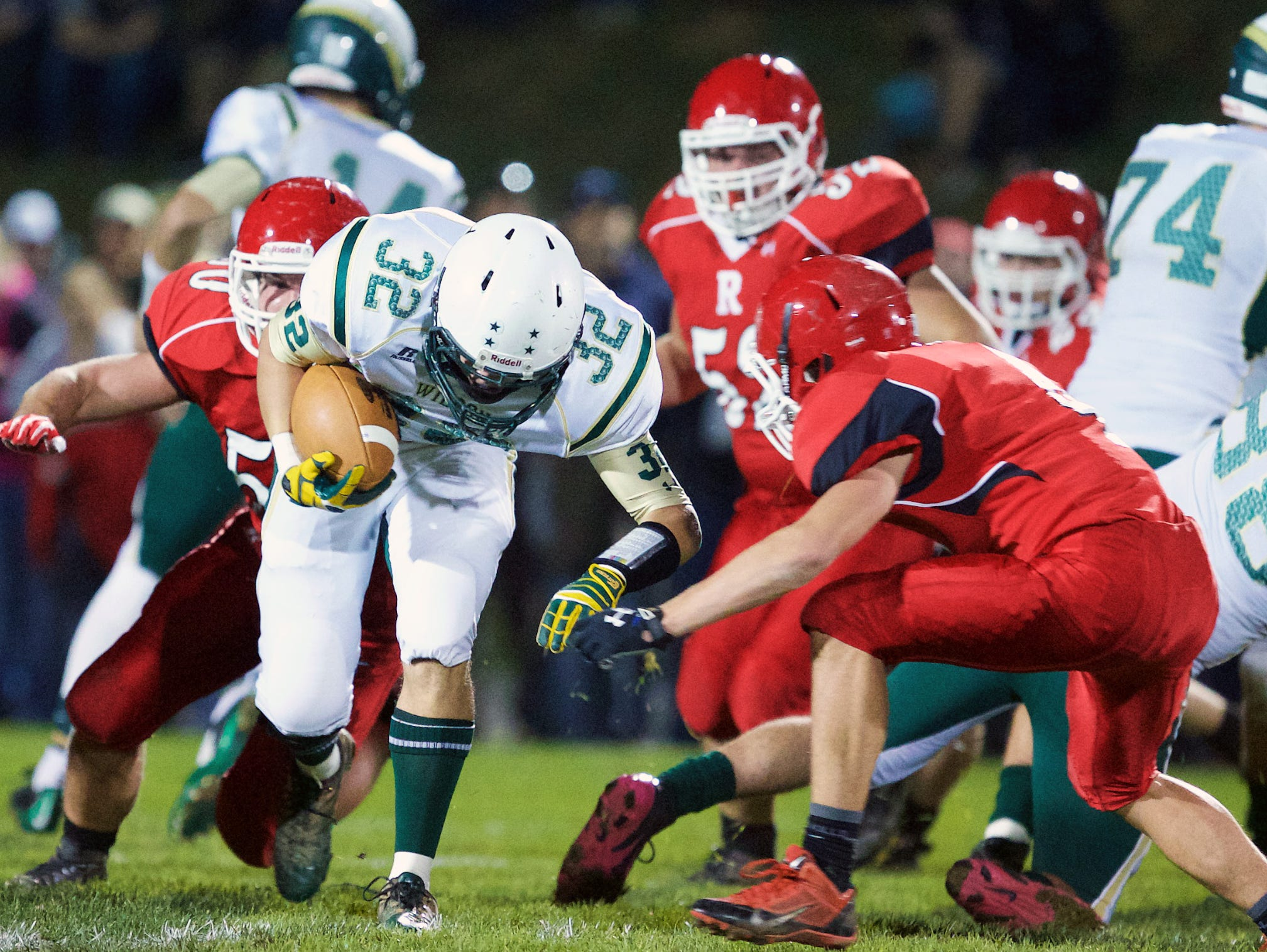 Wilson Memorial's Connor Chapman, left, gains yardage against Riverheads on Oct. 17, his first game back since suffering a knee injury in the second week of the season.