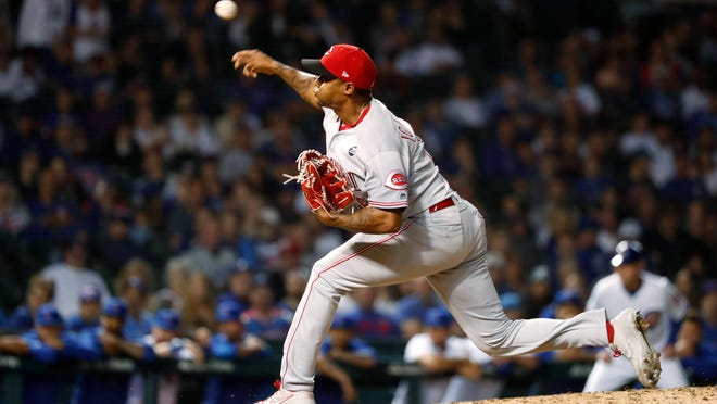 Cincinnati Reds relief pitcher Raisel Iglesias delivers during the 10th inning of the team's baseball game against the Chicago Cubs on Wednesday, Sept. 18, 2019, in Chicago. The Reds won 3-2 in 10 innings.(AP Photo/Charles Rex Arbogast)