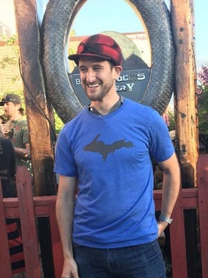TickPick co-founder and co-CEO Brett Goldberg tries on some Upper Peninsula swag June 20, 2017 at Blackrocks Brewery in Marquette.