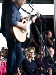 Nashville Mayor Megan Barry listens as Peter Frampton