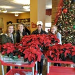 Oshkosh Southwest Rotary Rotarians deliver holiday cheer for Carrie's Cause