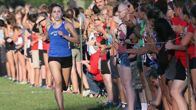 Camille Davre, a senior at Whitefish Bay, finished first on the girls side at the Arrowhead cross country invitational.