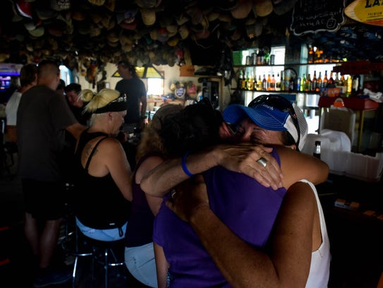 Karren Knapp and Naomi Jenkins hug at Shorty's Place
