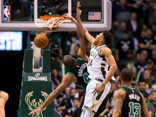 Bucks forward Giannis Antetokounmpo dunks over Celtics