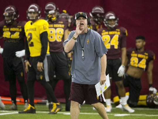 ASU offensive coordinator Chip Lindsey shouts during an ASU football practice at the Verde Dickey Dome in Tempe on Tuesday, August 9, 2016.
