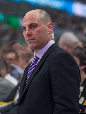 Mar 19, 2015; Dallas, TX, USA; Pittsburgh Penguins assistant coach Rick Tocchet watches his team take on the Dallas Stars at the American Airlines Center. The Stars defeated the Penguins 2-1. Mandatory Credit: Jerome Miron-USA TODAY Sports