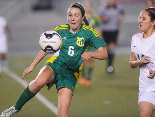 York Catholic's MaCayla Welsh, left, sends the ball