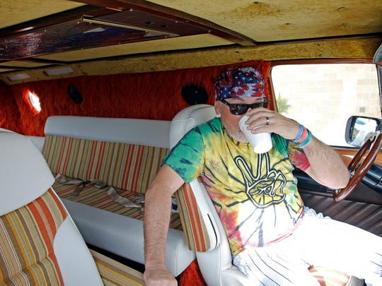 Chicago Cubs manager Joe Maddon sits in his van before