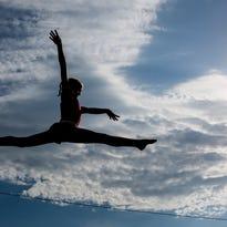 Flames gymnasts return from successful weekend in Battle Creek