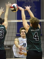 Dallastown's Jacob Horning blasts the ball past Central