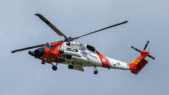 A Coast Guard boat scanned the water and helicopter hovered over South Haven's north beach after a 20-year-old Lansing man was last seen walking into the waves and never came out just after 9 p.m. Sunday.