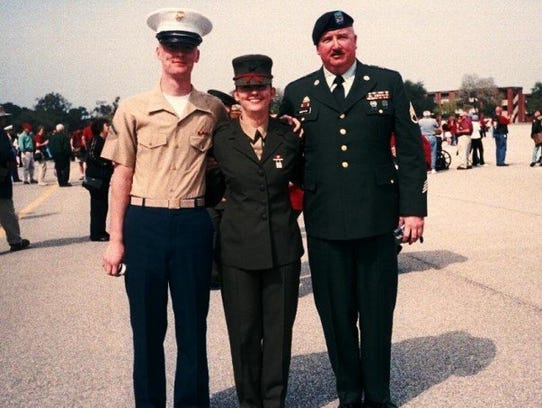 Marine Private Tegan Griffith (center) on the day she