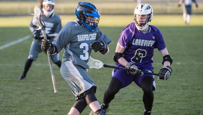 Harper Creek's Noah Bausenrman (32) and Lakeview's Cam Gillette (6) during a recent match.
