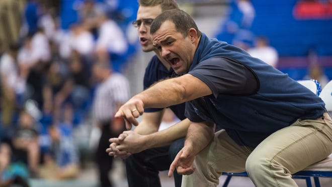 Chambersburg's wrestling coach Matt Mentzer shouts out advice from the sideline as Drake Brenize wrestle during the Trojan Wars tournament on Friday, Dec. 30, 2016 at Chambersburg.