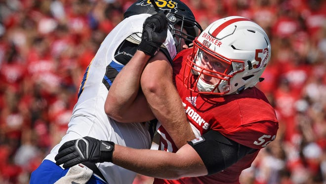 Nathan Brinker of St. John's rushes tries to get past a block while rushing the St. Scholastica quarterback during the first half of the Saturday, Sept. 2, game at Clemens Stadium in Collegeville.